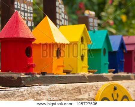 Bee hive brigt rainbow houses close up no people concept