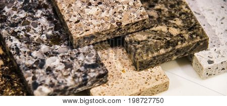 Kitchen counter tops of granite marble and quartz, blurry background of granite kitchen countertops, assortment kitchen counters, countertop samples, granite counter colors, kitchen worktops on marble counter top