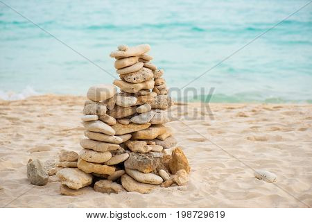 Balance stone on sea coast. Zen rocks on the beach. Feng Shui balance.