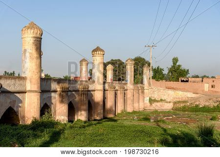 Mughal style arch bridge over the canal in suburbs of Peshawar city Pakistan