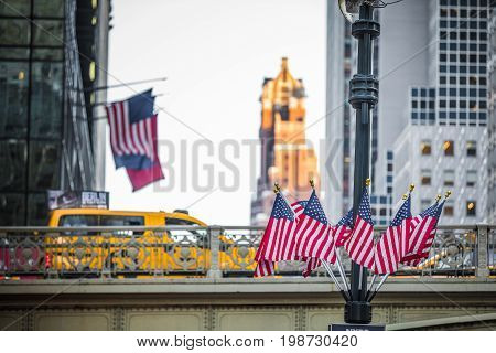 Bridge And Usa Flags At The Exit Of The Grans Central Subway Station In Manhattan, New York.
