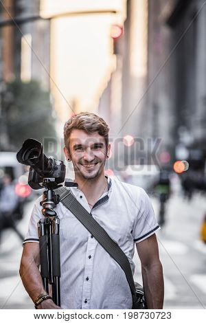 Profesionnal Photographer Standing In The Street Of New York During Sunset