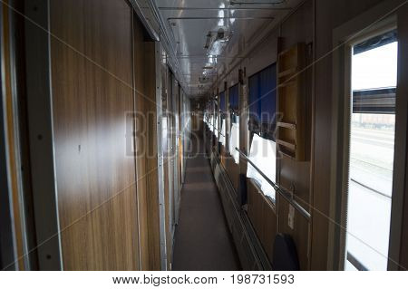 Corridor in the compartment car of a passenger train.