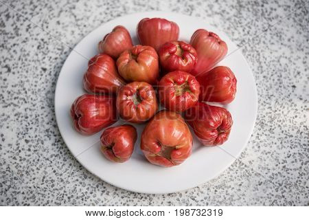 Java apples (Syzygium) on a plate. The fruit is also known as Semarang rose-apple (rose apple) or wax jambu