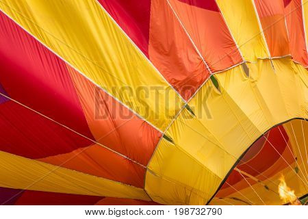 Fire fuels a hot air balloon in yellow, orange and red