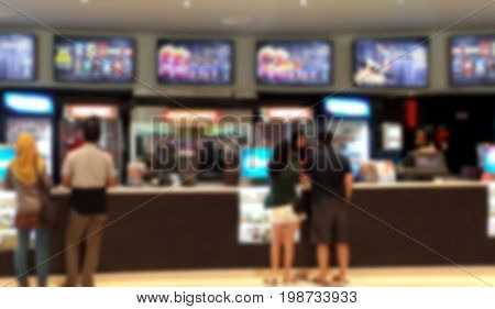 Blurred background of People buying snacks at cinema food counter