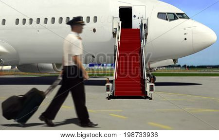 Pilot walking to airplane for take off