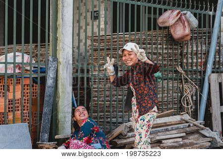 Can Tho, Vietnam - December 5, 2016: Two Vietnamese women workers (unidentified) pose and smile.