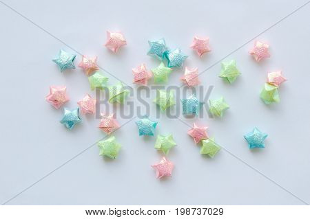 colorful star paper spreading on white background
