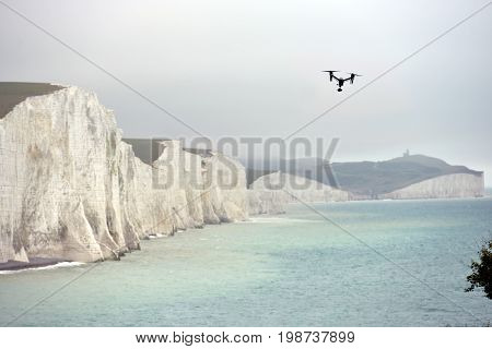 Drone being flown near the iconic Seven Sisters chalk cliffs