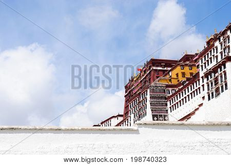 The Potala palace wall in Lhasa, Tibet and the blue sky with copy space