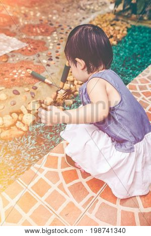 Asian Child With Gardening Equipment. Outdoors For Children. Vintage Tone.