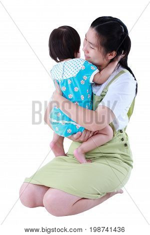 Happy Asian Mother Carrying Her Daughter. Isolated On White Background.