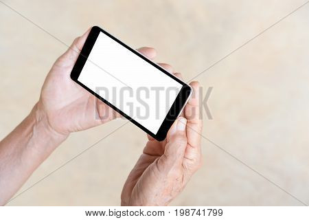 older person, hand holding and touch smart phone with blank white screen