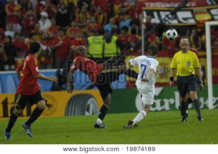 INNSBRUCK - JUNE 10: Marcos Senna of Spain (in red) & Dmitri Torbinskiy of Russia (in white)  during the match Spain-Russia 4:1 Euro2008 Group D. June 10, 2008, in Innsbruck, Austria