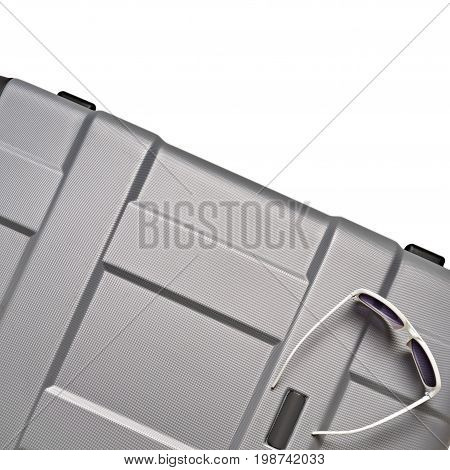 Gray Valise And Glasses