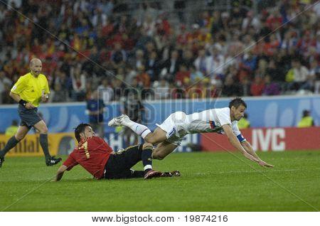 INNSBRUCK - JUNE 10: Sergei Semak of Russia (in white) & David Villa of Spain (in red)  during the match Spain-Russia 4:1 Euro2008 Group D. June 10, 2008, in Innsbruck, Austria