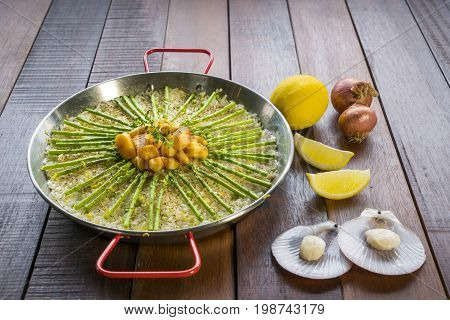 Paella With Scollops And Asparagus In Traditional Pan