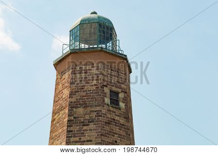 VIRGINIA BEACH, VIRGINIA - JULY 11, 2017:  Close-up view of the top of the Old Cape Henry Lighthouse, built in 1792, it is located on the Fort Story military base.