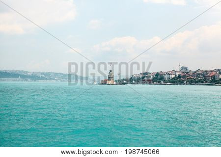 The lighthouse on the Bosporus between the Asian and European parts of Istanbul. On the right is the Asian part of the city, on the left is the European part. A beautiful view of the city.