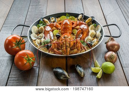 Paella With Fresh Lobster, Clams, Mussels And Lime