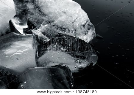Ice block / An ice cube is a small, roughly cube-shaped piece of ice, conventionally used to cool beverages