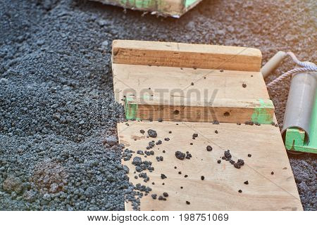 Wooden board for volcano ride on ash stones background