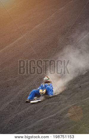 Woman on volcano sand boarding tour in NIcaragua cerro negro