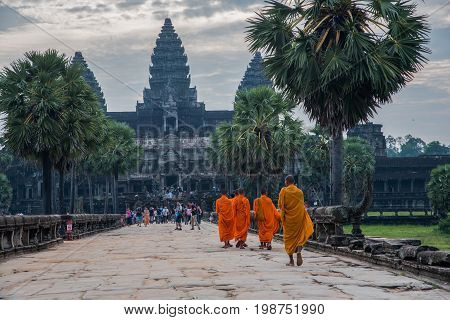 Sunrise at Angkor WatBuddhism monk walking to Angkor wat most popular among tourists ancient landmark and place of worship in Southeast Asia.4 Oct 2016 Siem Reap Cambodia.