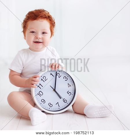 Happy Little Toddler Baby Holding Circle Clock