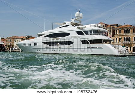 VENICE ITALY - JUNE 10 2017: The luxury yacht Reef Chief moored on the Riva dia Schiavoni on a sunny Summer afternoon in Venice Italy. The boat is owned by the American James Dicke CEO of the truck manufacturers Crown Equipment Corporation.