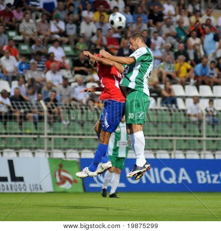 KAPOSVAR, HUNGARY - AUGUST 15: Attila Zabos (L) and Srdan Stanic in action at Hungarian National Championship soccer game Kaposvar vs Nyiregyhaza August 15, 2009 in Kaposvar, Hungary.