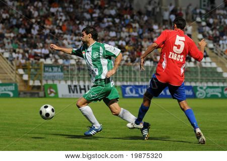 KAPOSVAR, HUNGARY - AUGUST 15: Nikolic Nemanja (L) and Attila Zabos in action at Hungarian National Championship soccer game Kaposvar vs Nyiregyhaza August 15, 2009 in Kaposvar, Hungary.