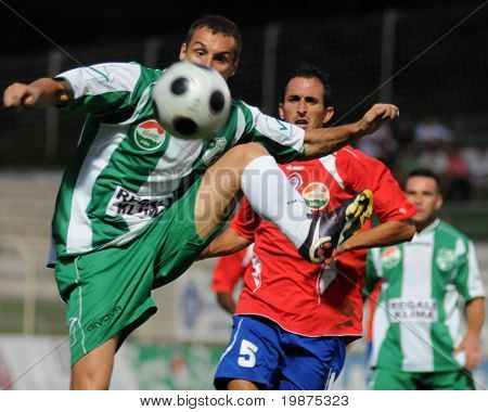 KAPOSVAR, HUNGARY - AUGUST 15: Srdan Stanic (L) and Attila Zabos in action at Hungarian National Championship soccer game Kaposvar vs Nyiregyhaza August 15, 2009 in Kaposvar, Hungary.