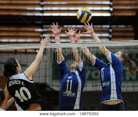 KAPOSVAR, HUNGARY - FEBRUARY 7: Erzsebet Kovacs (L), Marianna Palfy (C), and Timea Kondor in the Hungarian Extra League woman volleyball game Kaposvar vs UTE, February 7, 2009 in Kaposvar, Hungary.
