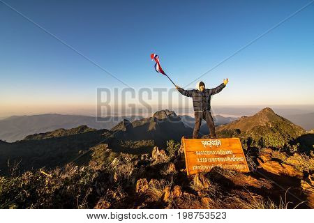 Happy man gesture raised arms. Funny hiker with arms raised in the air. Vivid and vignetting effect.