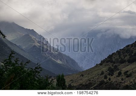 Mountains landscape clouds c of Kyrgyzstan on the road at the Issyk-ATA gorge