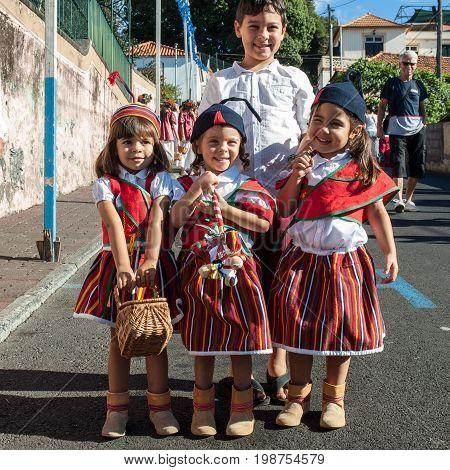 ESTREITO DE CAMARA DE LOBOS PORTUGAL - SEPTEMBER 10 2016: Children wearing in traditional costumes at Madeira Wine Festival in Estreito de Camara de Lobos Madeira Portugal.