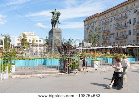 MOSCOW - AUGUST 7: Women gardener Yuri Dolgoruky monument and flower beds in Tverskaya Square on August 7 2017 in Moscow. Flower beds were installed during