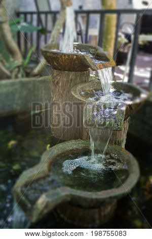 Garden decorated with vintage fountain stock photo
