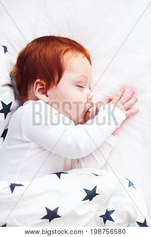 Top View Of Redhead Infant Baby Sleeping Peacefully In Bed