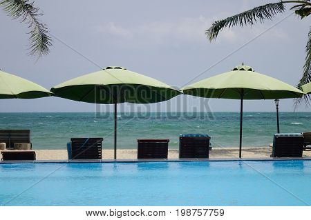 Ralaxing Chairs At Swimming Pool Of Luxury Resort
