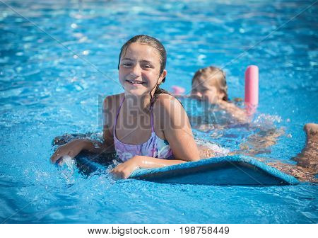cute little girl is swimming in the pool on the blackboard