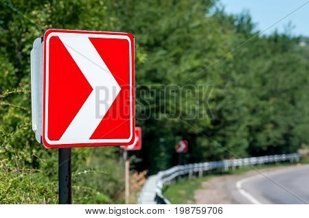 Right Turn Sign. Road signs warn of a sharp turn.