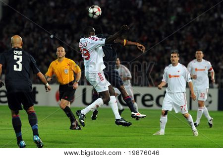 BUDAPEST - SEPTEMBER 29: Coulibaly (39) and Makoun in action at the UEFA Champions League football game Debrecen vs Lyon, UEFA Champions League football game, September 29, 2009 in Budapest, Hungary.
