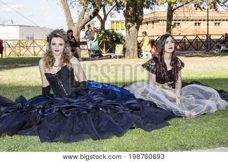 CAGLIARI ITALIA - MAY 29 2016: Sunday at the Great Jatte VIII Ed. At the Public Gardens - portrait of beautiful women wearing a Victorian-style costume - Sardinia