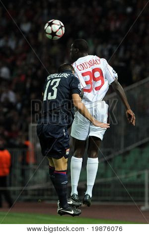 BUDAPEST - SEPTEMBER 29: Reveillere and Coulibaly in action at the UEFA Champions League football game Debrecen vs Lyon, UEFA Champions League football game, September 29, 2009 in Budapest, Hungary.