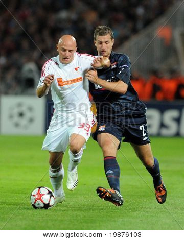 BUDAPEST - SEPTEMBER 29: Varga (33) and Clerc in action at the UEFA Champions League football game Debrecen vs Lyon, UEFA Champions League football game, September 29, 2009 in Budapest, Hungary.