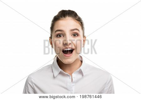 Head And Shoulders Shot Of Surprised Caucasian Teenage Girl In White Shirt Isolated On White