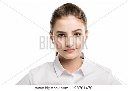 Head And Shoulders Shot Of Caucasian Teenage Girl In White Shirt Isolated On White